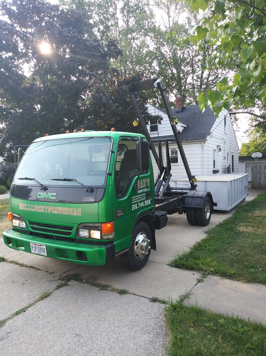 Dad's Dumpsters LLc roll-off truck, 10 yard dumpster rental